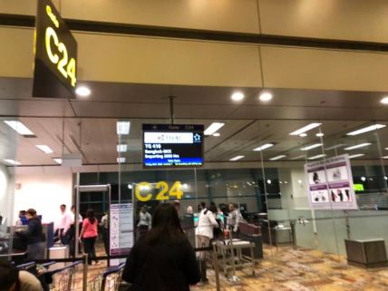 Thai Airways departs from Gate C24 in Singapore Changi Airport Terminal 1