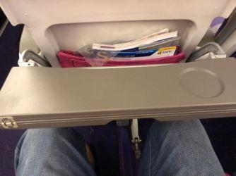 Bi-fold tray table in Economy Class cabin