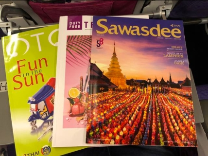 In-flight magazines in the seat pocket