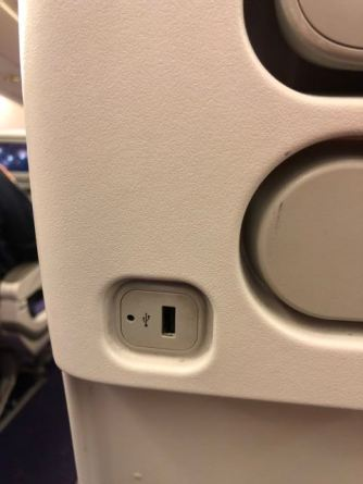 USB outlet below the IFE screen