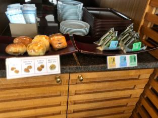 Bread and onigiri offered in Royal Orchid Lounge