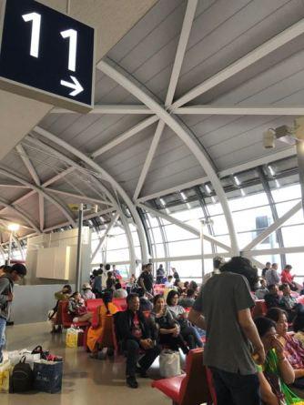 TG623 KIX-BKK departs at Gate 11 in KIX satellite terminal