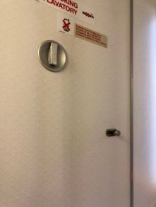 Coat hanger on the back of the lavatory door