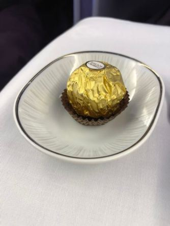 A single chocolate was served to passengers in Business Class cabin after the ice-cream