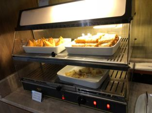 Hot snacks in Royal Orchid Lounge at Concourse E