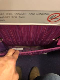 A deep (and dirty) seat pocket onboard Thai Airways B777-300 Economy Class cabin