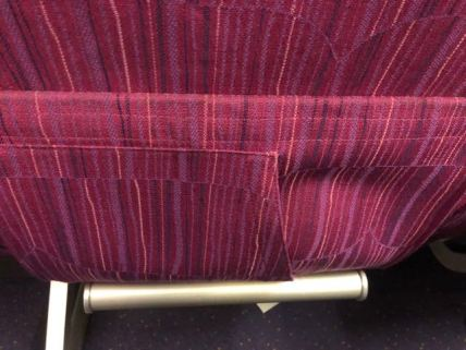 A smaller pocket in front of the main seat pocket