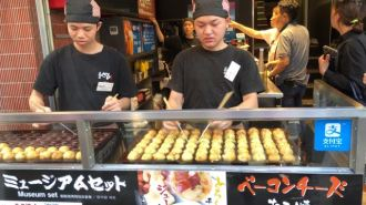 Staff preparing our takoyaki balls