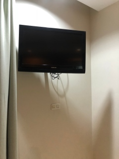 TV is mounted on the other corner in the third bedroom