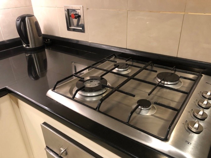 Four-gas stove allows guests of the 2-bedroom apartment to do some simple cooking