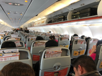 The cabin onboard Jetstar A320-200 is brightly lighted