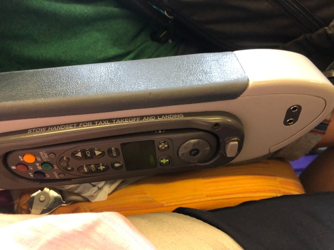 IFE controller is stowed in the same armrest as the headphone jack