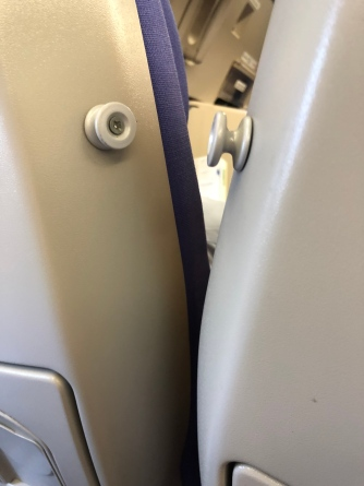 Coat hooks on the seat which is placed in a weird position
