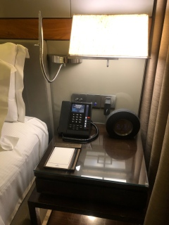 Bedside table in the bedroom of the Executive Suite