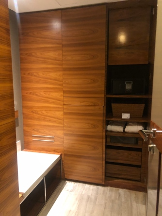 Wardrobe with shelving inside the bathroom