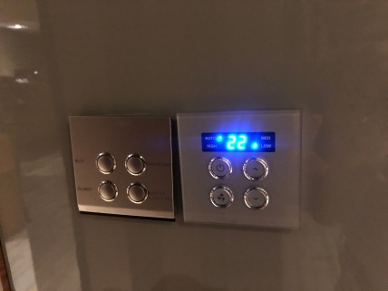 Light and air-con controls in the bedroom