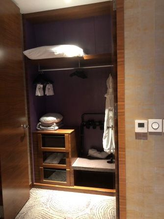 The walk-in wardrobe in the bedroom