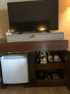 The mini bar is hidden beneath the TV