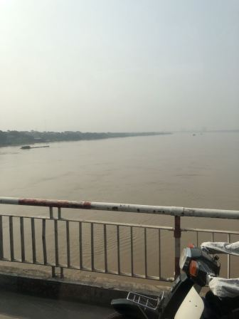 Driving over the Red River in Hanoi