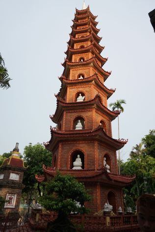 The bricked Tran Quoc Pagoda has statues of Buddhas on each of the 11 tiers
