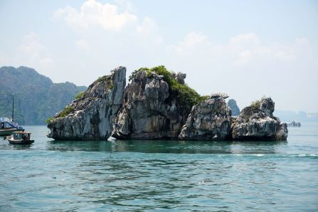Sailing past some of the limestone islands in Halong Bay