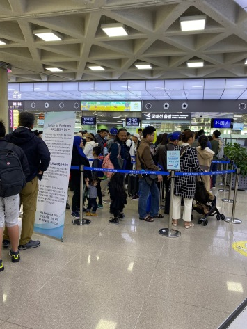 A huge queue for foreign passengers taking Domestic flight in Jeju Airport