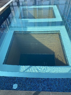 One can see into the indoor pool from here