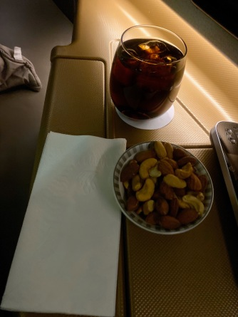 Warm nuts and beverages was served after the seat belt sign is turned off