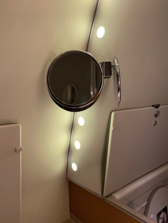 Small vanity mirror in the lavatory