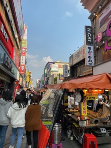 There is a shopping street opposite Suwon Station with push carts selling street food