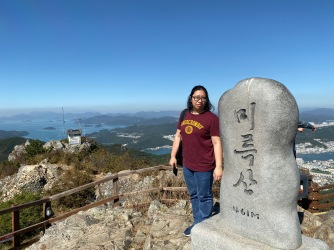My friend with the tablet at the summit of Mireuksan
