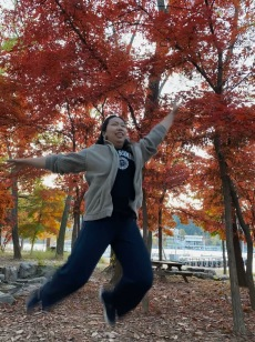 My friend doing some flying pose on Nami Island