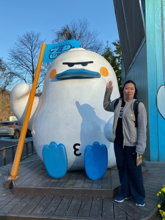 My friend with the mascot of the zip line to Nami Island