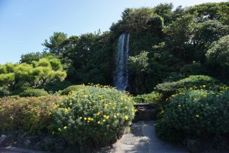 A small man made waterfall after the entrance in Jeju Folk Village